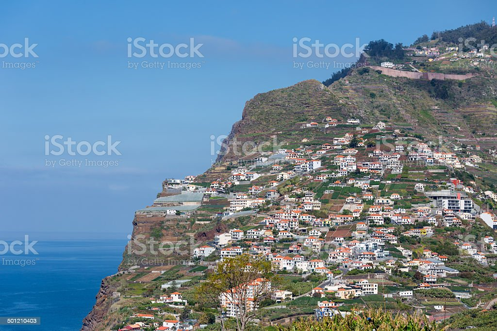 Madeira Island with houses built at a cliff stock photo