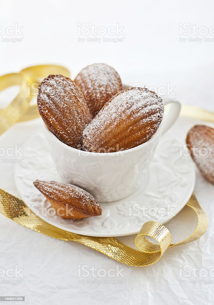 Madeleines cookies  in a white cup royalty-free stock photo