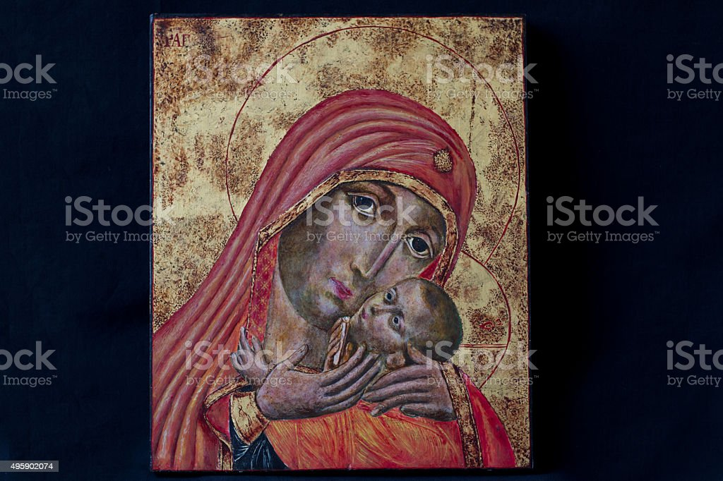 Madonna and Child Icon in Orange and Gold; Black Background stock photo