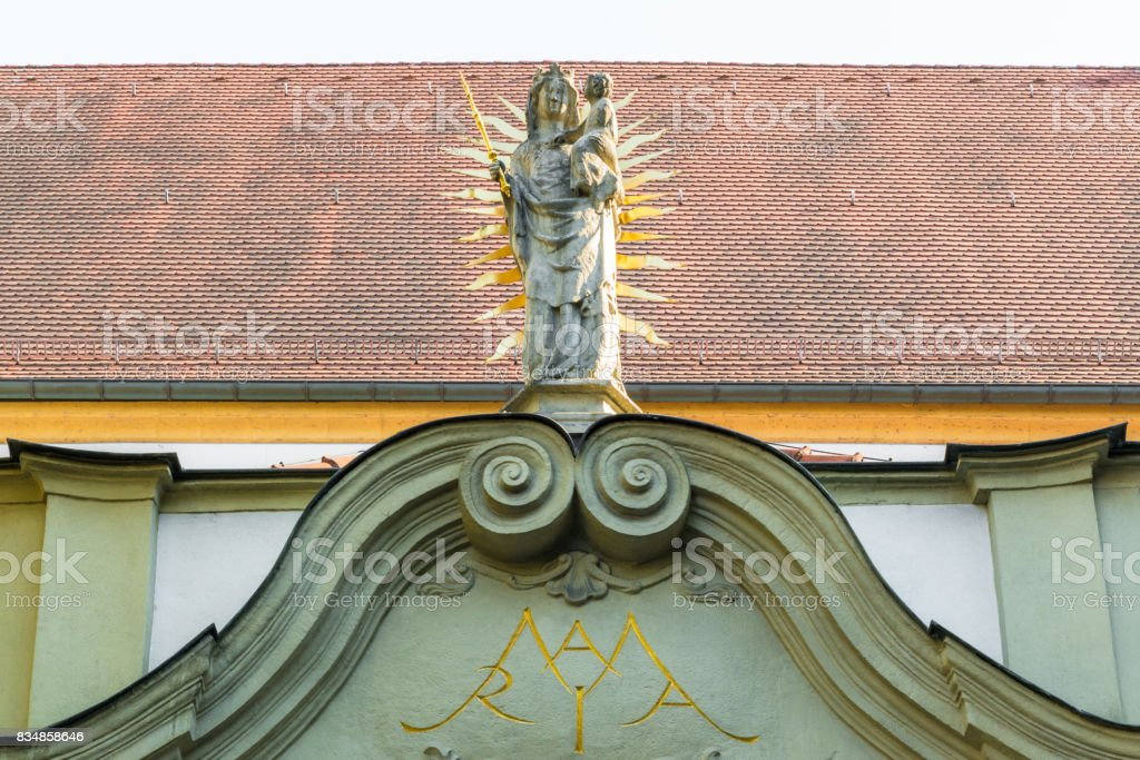 Madonna statue at the north portal of the collegiate church, old chapel, in Regensburg, Germany stock photo
