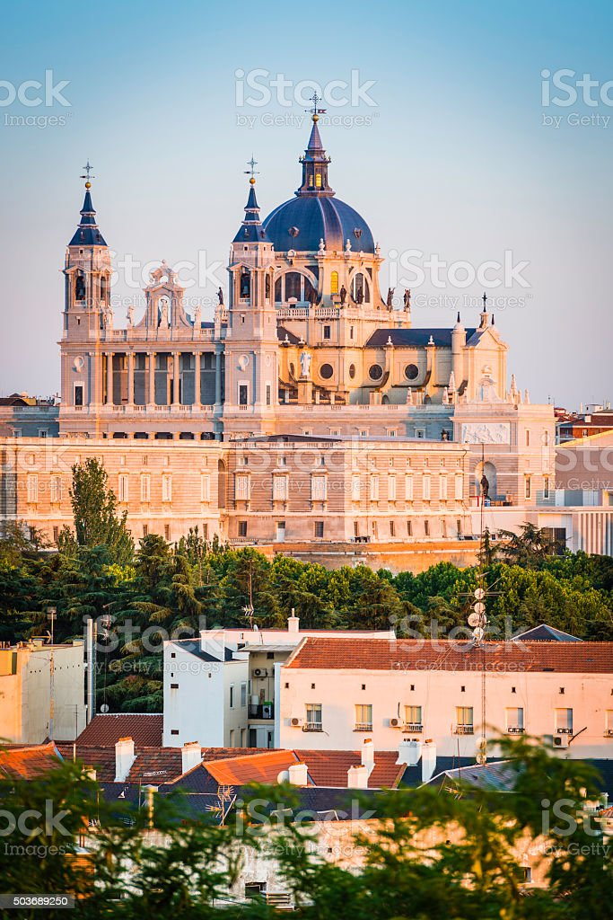 Madrid Almudena Cathedral overlooking city rooftop skyline at sunset Spain stock photo