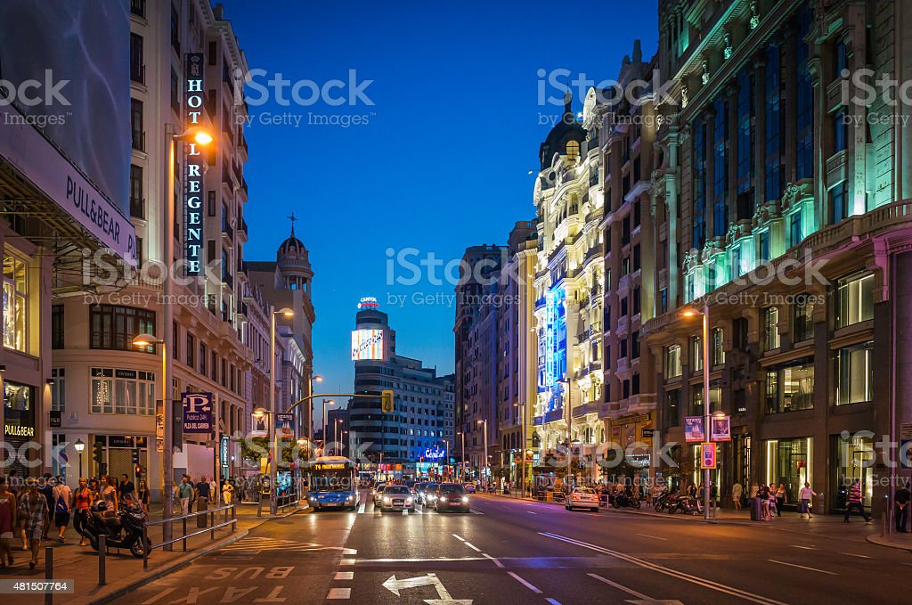 Madrid Gran Via shoppers and stores illuminated at dusk Spain stock photo