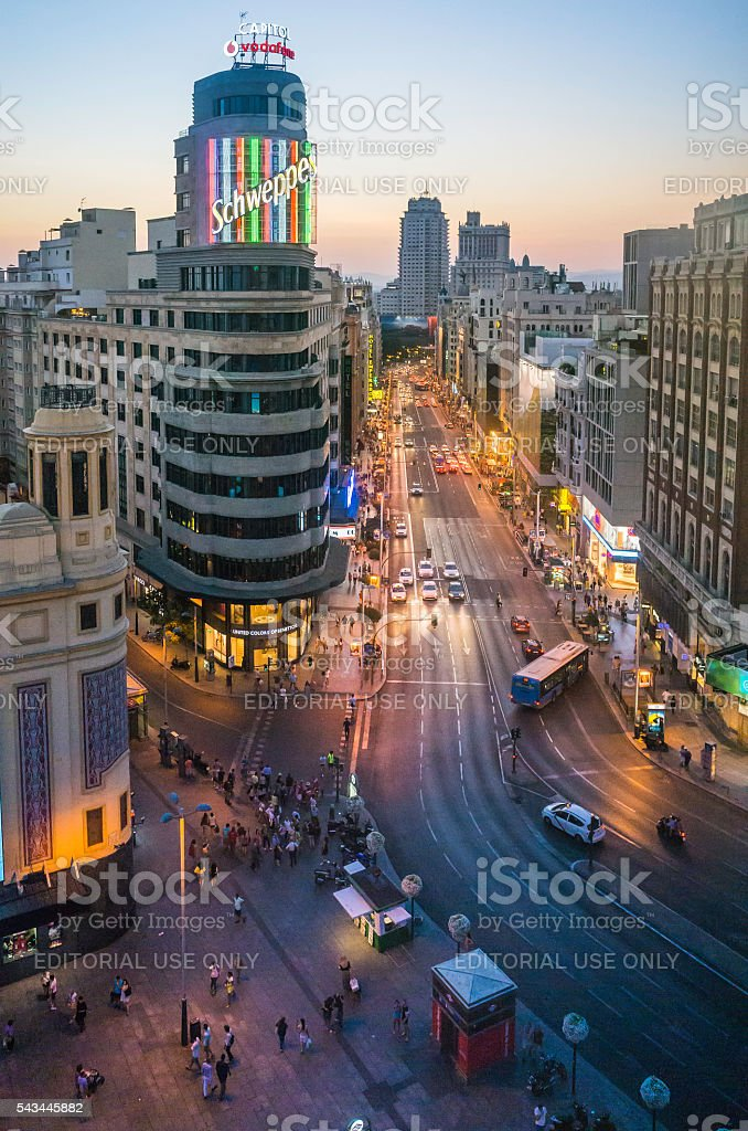 Madrid nightlife busy Gran Via iconic Schweppes neon sign Spain stock photo