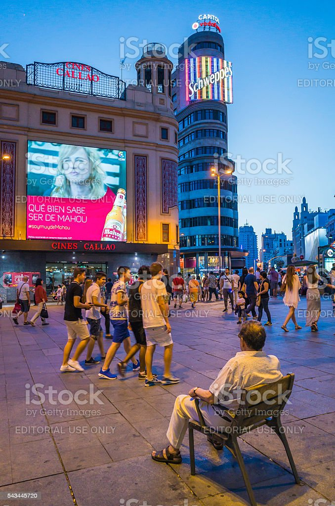 Madrid nightlife crowds below Schweppes sign Plaza del Callao Spain stock photo