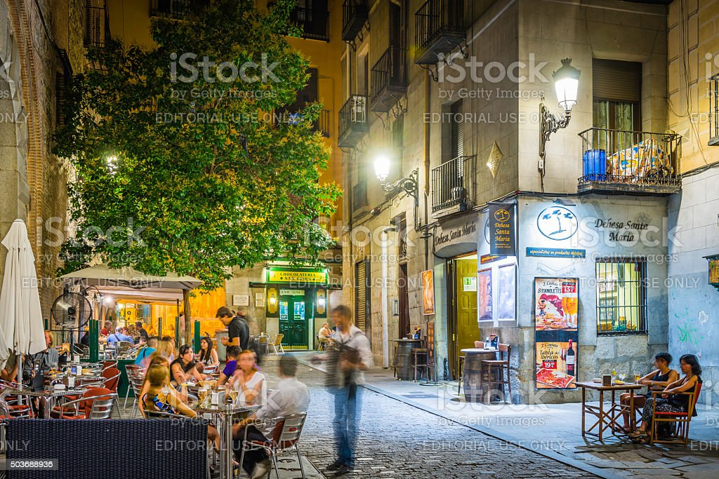 Madrid people relaxing al fresco restaurants warm night cafes Spain stock photo