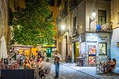 Madrid people relaxing al fresco restaurants warm night cafes Spain