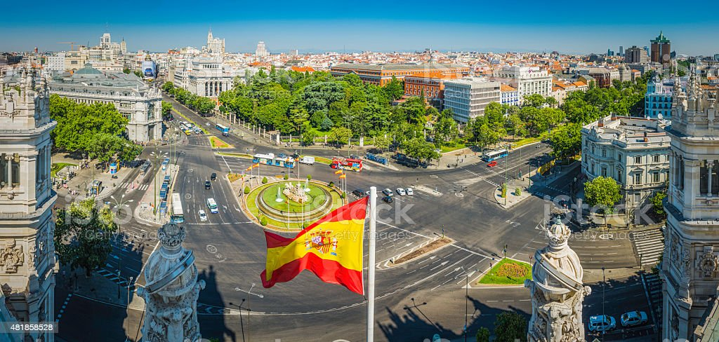 Madrid Plaza de Cibeles Spanish flag rooftop cityscape panorama Spain stock photo
