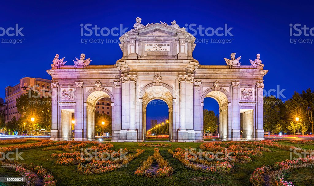 Madrid Puerta de Alcala iconic monumental gate illuminated dusk Spain stock photo