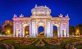 Madrid Puerta de Alcala iconic monumental gate illuminated dusk Spain