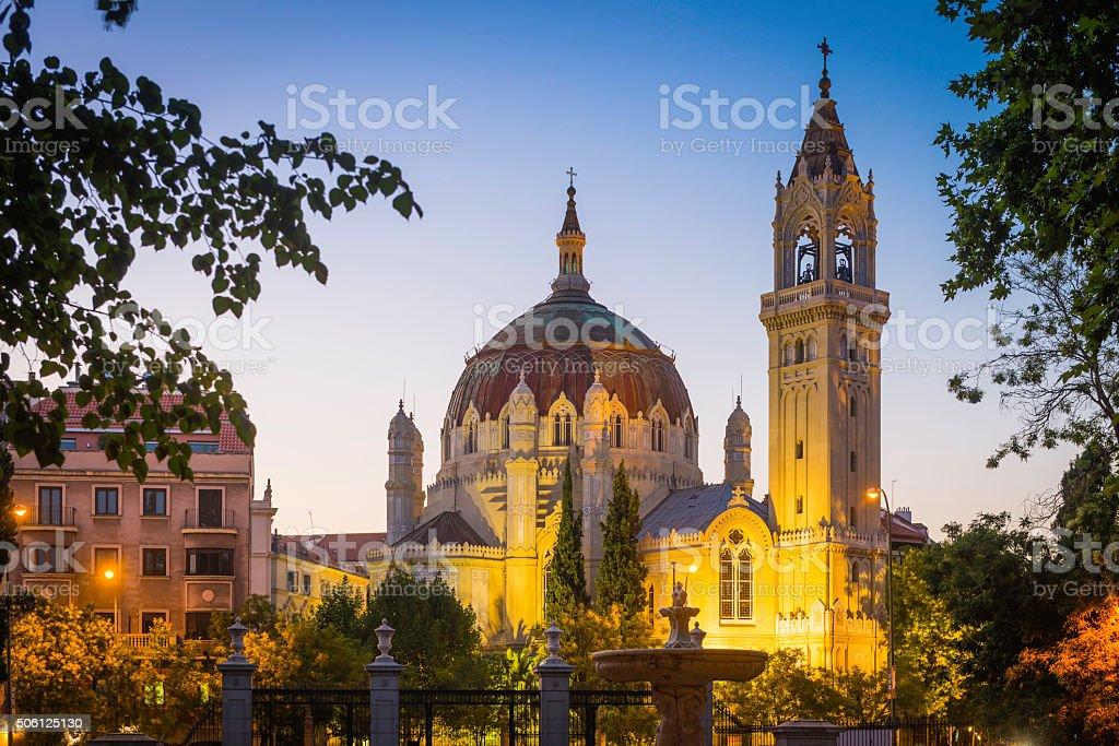 Madrid spires and domes illuminated at dusk Retiro Park Spain stock photo