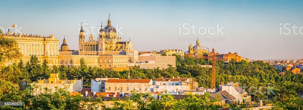 Madrid warm sunset light on Almudena Cathedral Palicio Real Spain stock photo