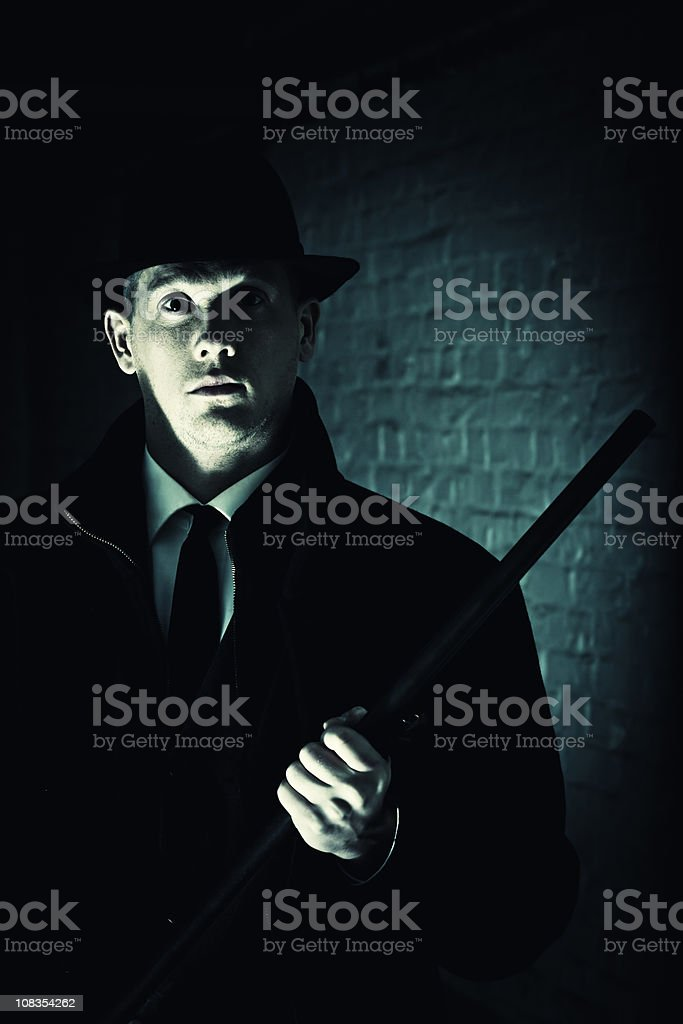 Mafia boss with gun in dark royalty-free stock photo