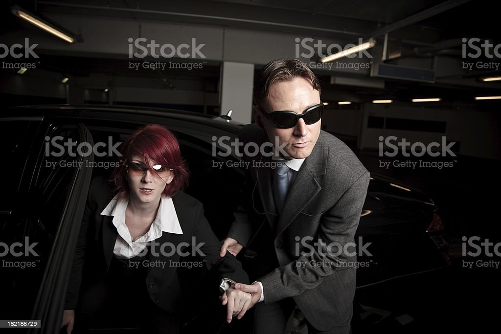 mafia chick getting out of the car royalty-free stock photo