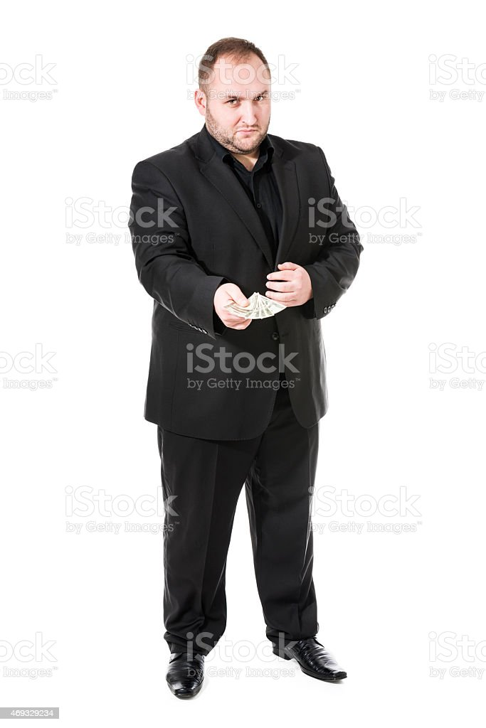 Mafia Gangster with Black Suit Holding US Dollar Money stock photo