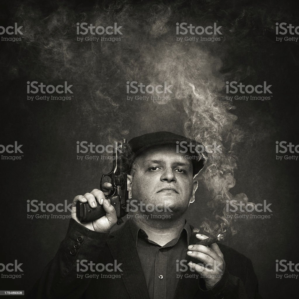 mafia guy with smoking colt and cigar stock photo
