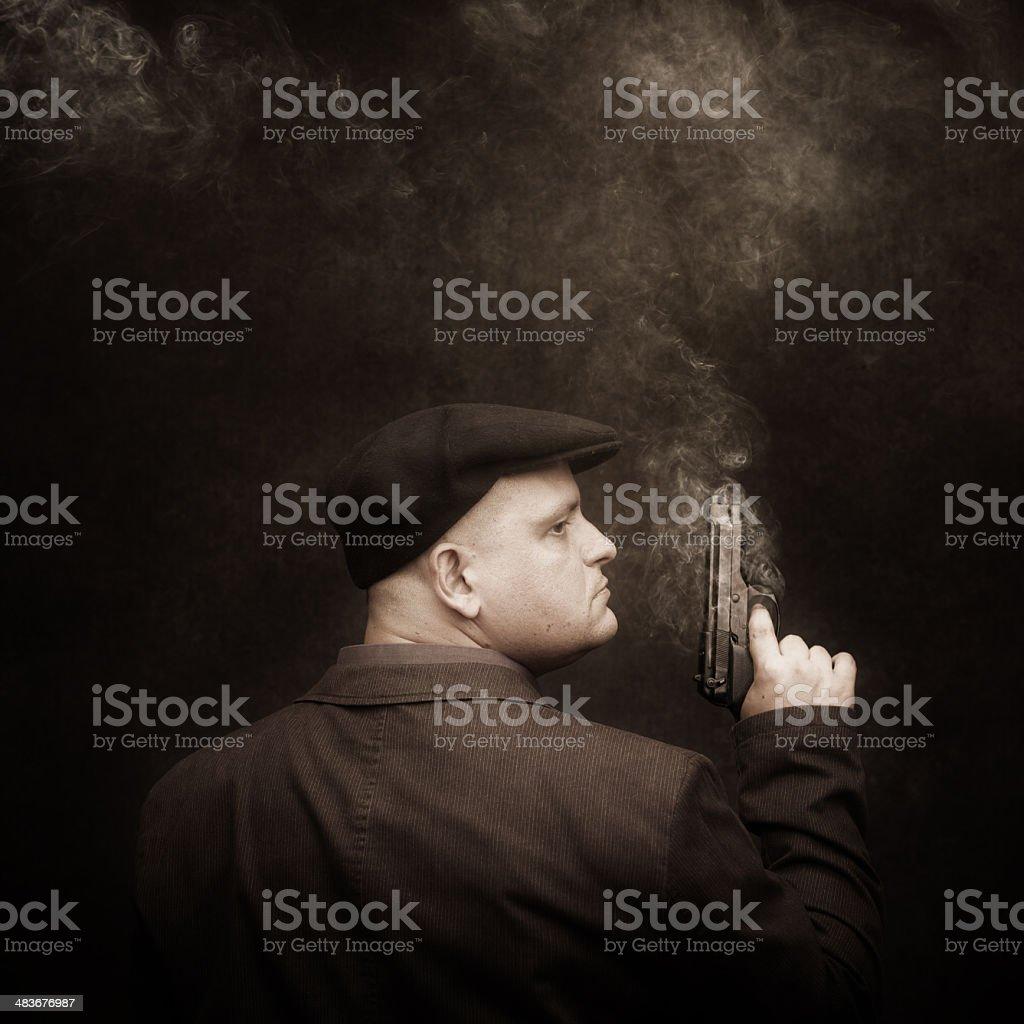 mafia guy with smoking colt royalty-free stock photo