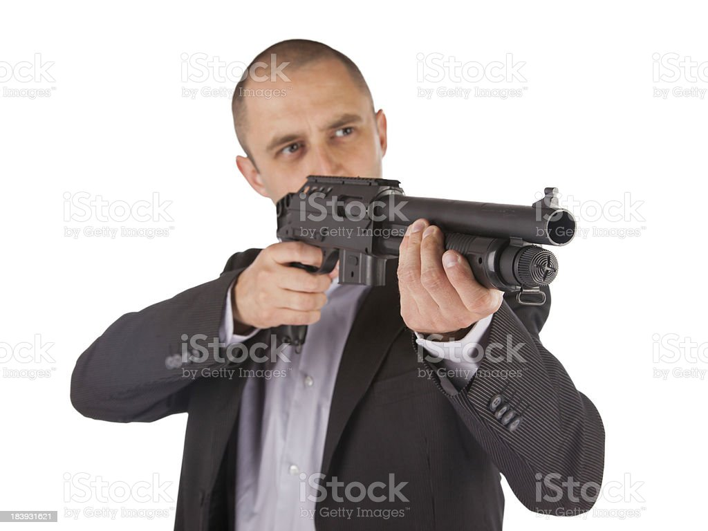 Mafia man is holding a shotgun royalty-free stock photo