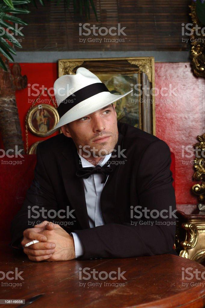 Mafia Man Sitting in Room and Smoking royalty-free stock photo