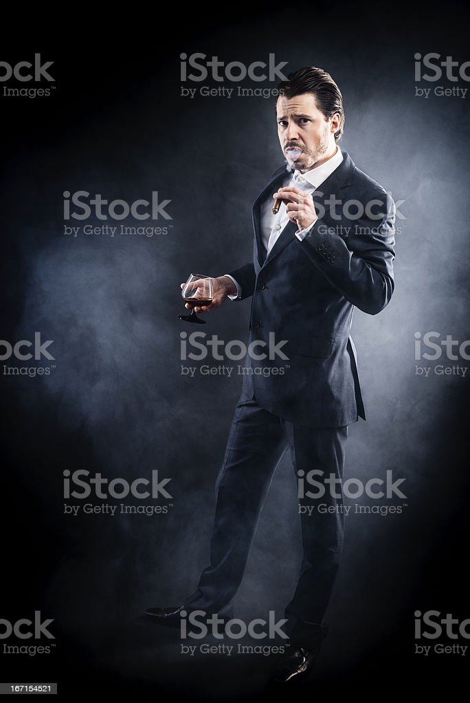 Mafioso, gangster, suit smoking cigar, angry face, slicked back hair stock photo