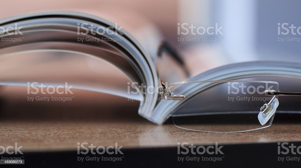Magazine and glasses stock photo