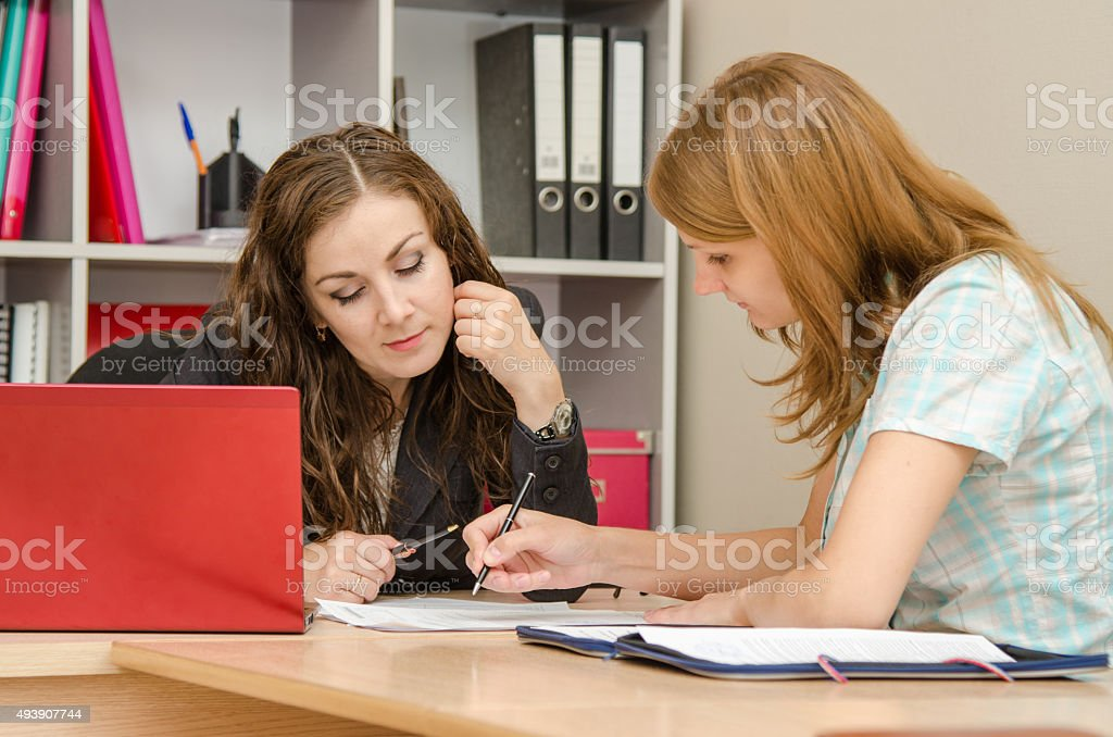 Magazine editor and journalist discussing article stock photo