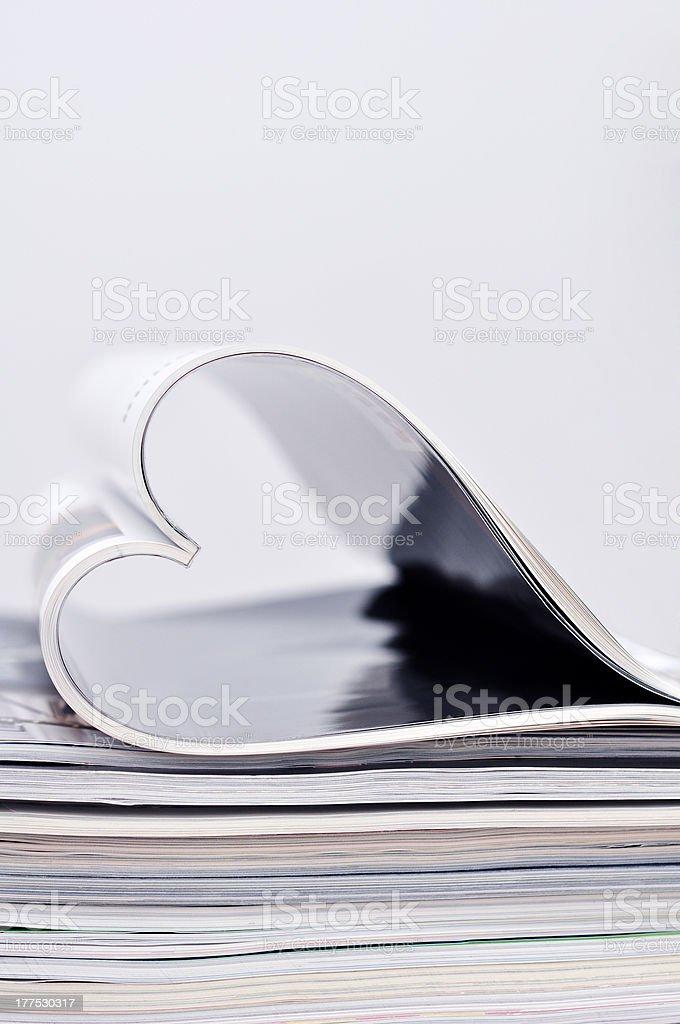 magazine folded into a heart shape royalty-free stock photo