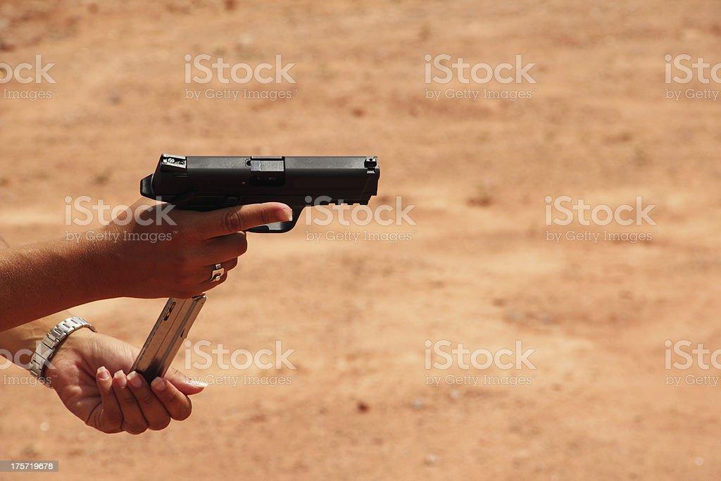 Magazine Gun Loading royalty-free stock photo