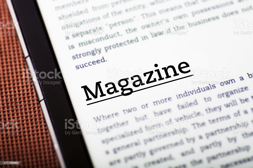 Magazine on tablet screen, ebook concept royalty-free stock photo
