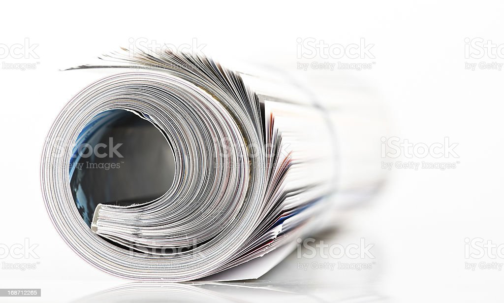 magazine roll on white background royalty-free stock photo