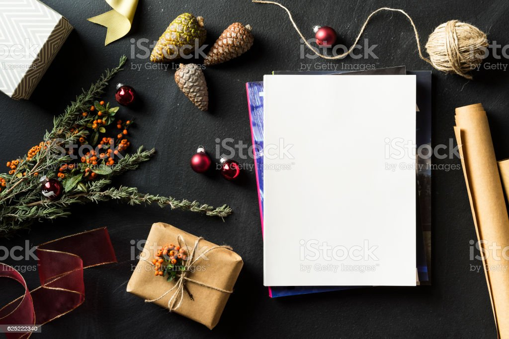 Magazine stack with blank cover in Christmas concept flat lay stock photo