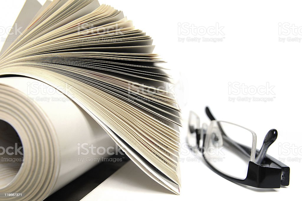 Magazine with glasses stock photo