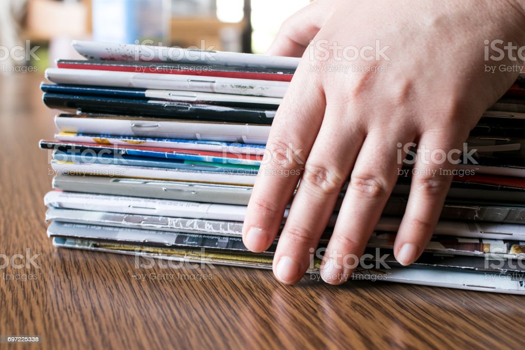 Magazines and hand stock photo