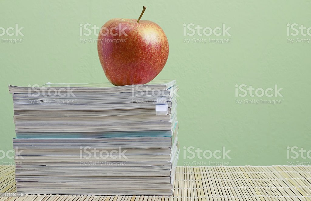 magazines and red apple royalty-free stock photo
