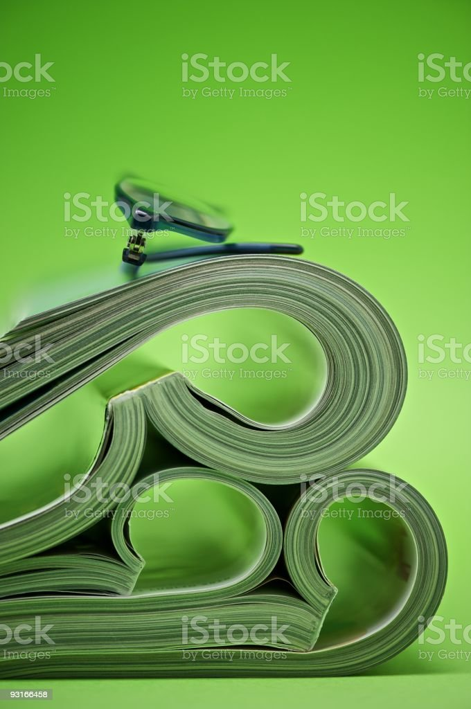 Magazines folded and glasses stock photo