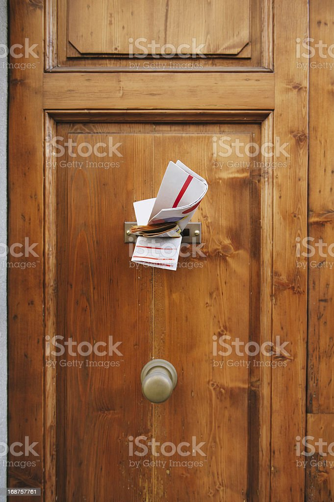 Magazines in letterbox of a door stock photo