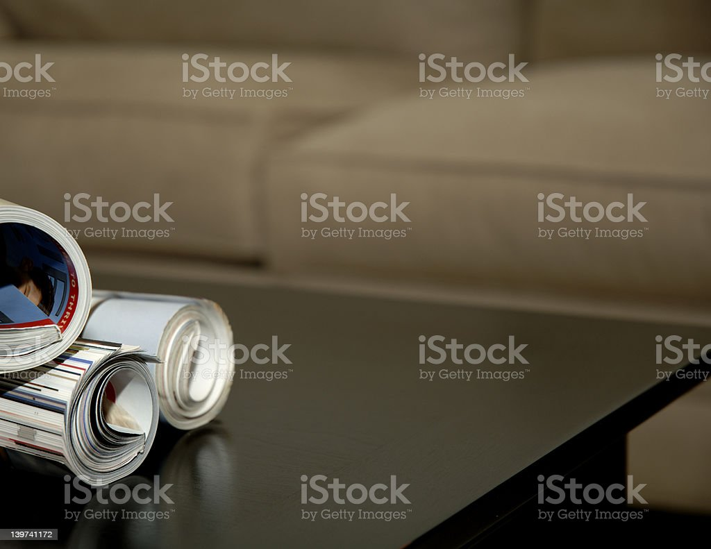 Magazines on coffee table royalty-free stock photo