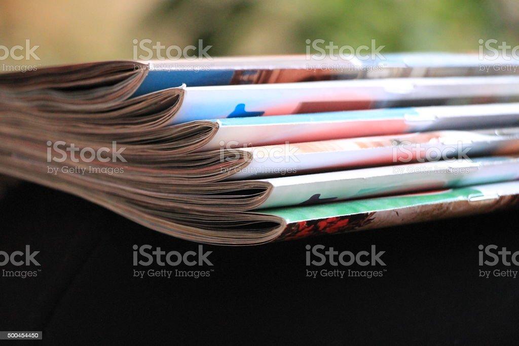 Magazines on the black sofa stock photo