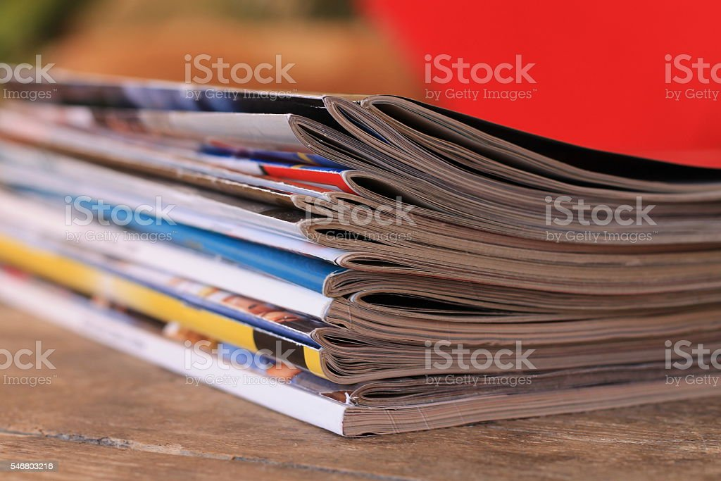 Magazines on the wooden table stock photo
