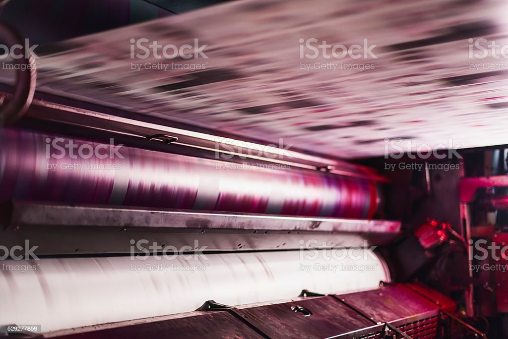 magenta colour cylinder in cmyk web offset printing press stock photo