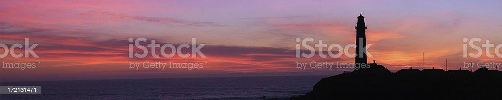 Magenta Lighthouse Sunset - Panorama stock photo