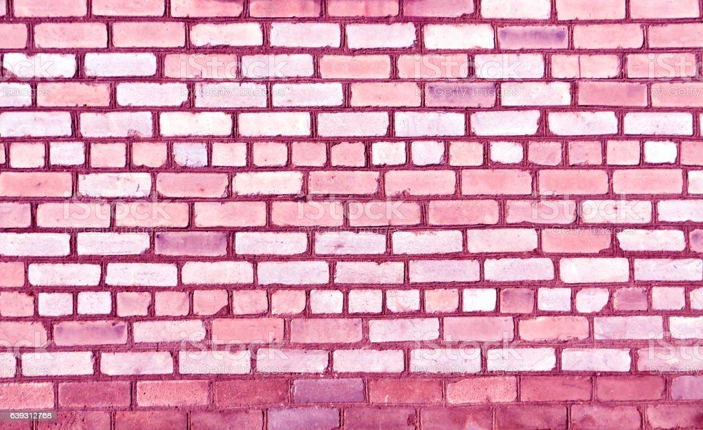 Magenta toned old brick wall texture. stock photo