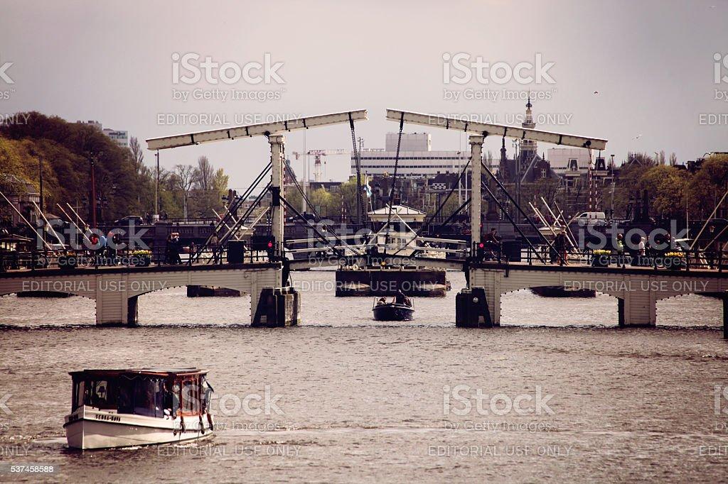 Magere skinny bridge over Amstel river in Amsterdam stock photo