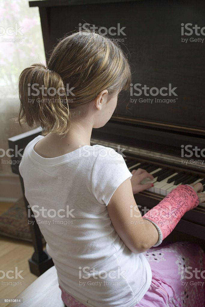 Maggie Plays Piano royalty-free stock photo