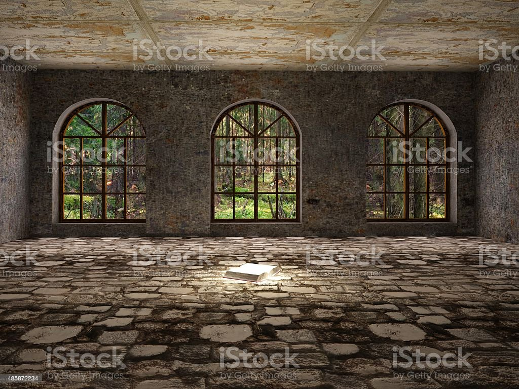 Magic book in abandoned castle. Knowledge is power. stock photo