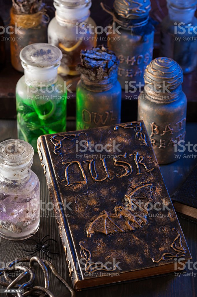 magic book witch apothecary jars potions halloween decoration stock photo