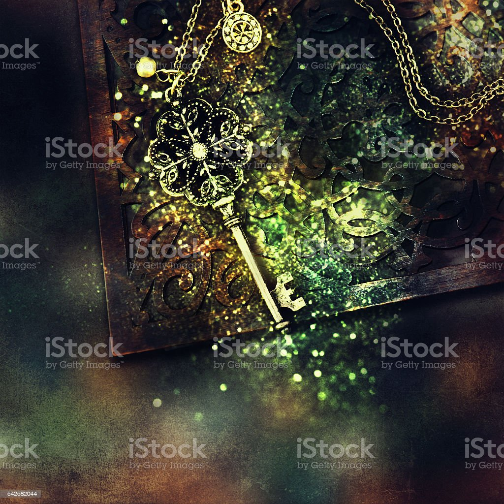 Magic book with gold vintage key. stock photo
