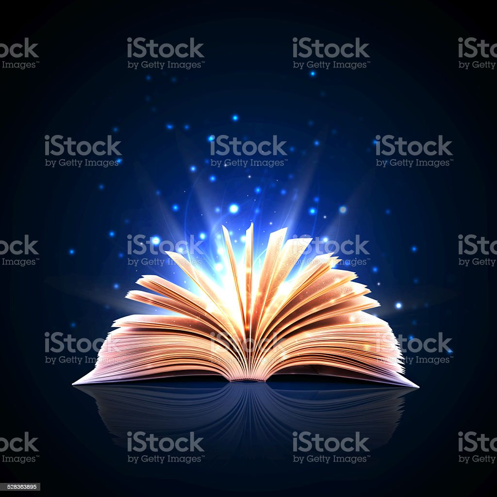 Magic book with magic lights stock photo