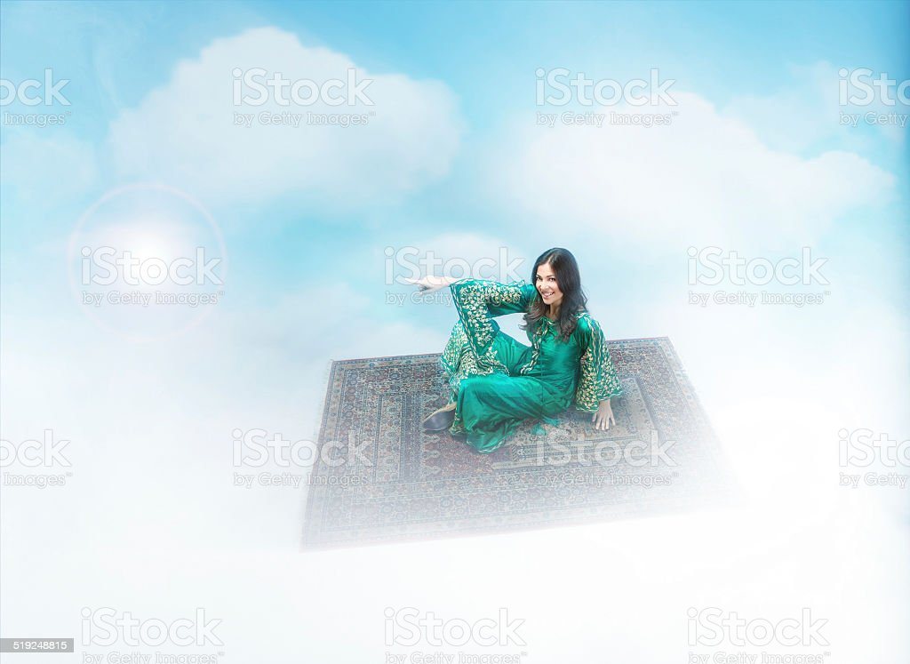 magic carpet flying with nice girl up stock photo
