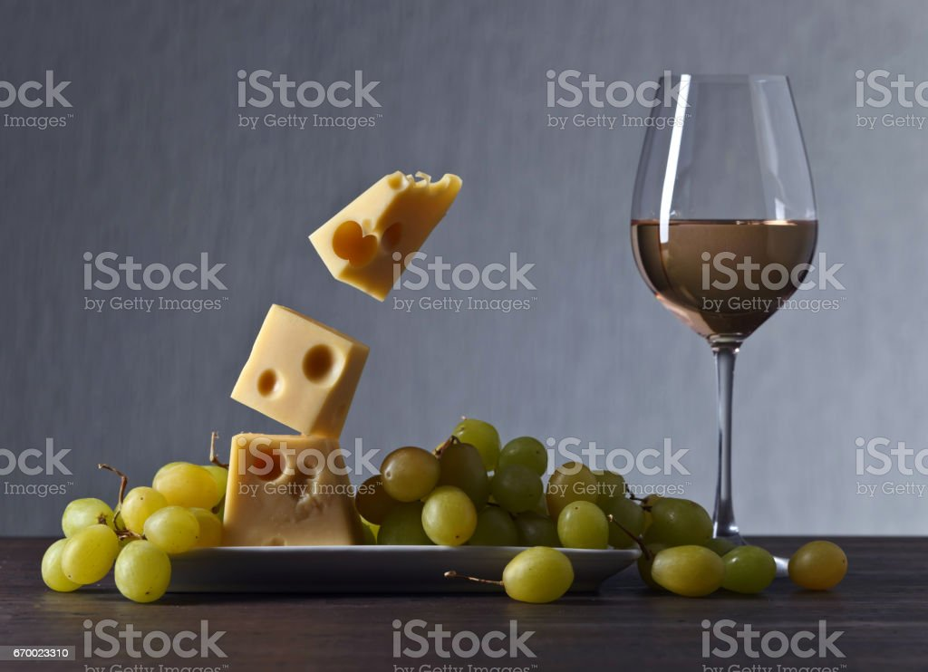 Magic cheese with grape and glass of white wine stock photo