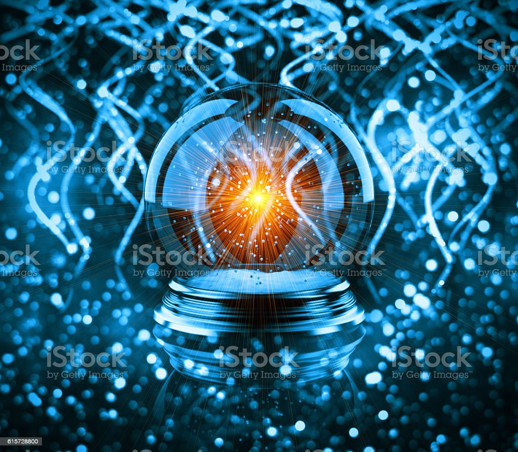 magic glass Christmas ball with ribbon bokeh stock photo